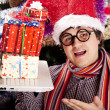 Funny men in christmas cap with gift boxes and notebook — Stock Photo #7498456