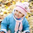 Cute girl in autumn park — Stock Photo