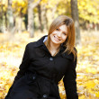 Smiling happy girl in autumn park — Stock Photo #7539599