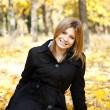 Smiling happy girl in autumn park — Stock Photo #7539599
