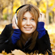 Portrait of a woman at outdoor with headphones — Stock Photo