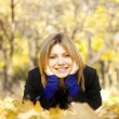 Smiling happy girl in autumn park — Stock Photo #7539618