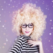 Portrait of funny girl in blonde wig. — Stock Photo