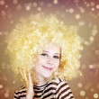 Portrait of funny girl in blonde wig. - Stock Photo