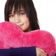 Beautiful brunette girl with toy heart. — Stock Photo #7694501