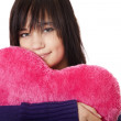 Beautiful brunette girl with toy heart. — Stock Photo