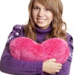 Blonde girl with toy heart at st. Valentine's day. - Stock Photo