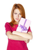 Sad red-haired girl with present box. — Stock Photo