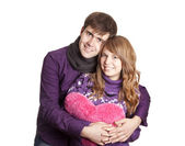 Beautiful couple with heart. Studio shot. — Stock Photo
