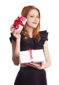 Beautiful red-haired girl with present boxes. — Stock Photo