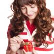 Beautiful brunette girl with present box. — Stock Photo