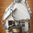 House with chain and padlock, — Stock Photo