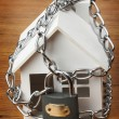 House with chain and padlock, — Stock Photo #7282292