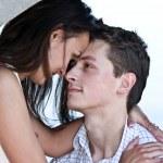 Beautiful man and the woman kiss ashore at the river — Stock Photo #7464844