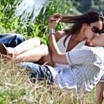 Beautiful pair - the man and the woman kiss ashore — Stock Photo