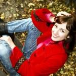 The joyful woman in a red coat — Stock Photo