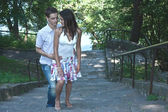 Enamoured man and the woman rise on steps in park — Stock Photo