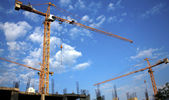 Yellow building cranes — Stock Photo