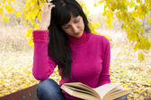 The beautiful woman reads the book — Stock Photo
