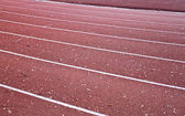 Red racetrack with white lines — Stock Photo