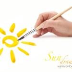 Hand with brush drawing sun — Stock Photo #7266879
