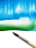 Abstract watercolor painted background and brush — Stock Photo