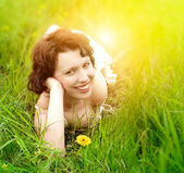 Beautiful young woman in grass — Stock Photo