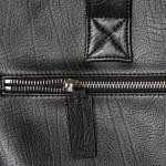 Closeup zipper on black leather — Stock Photo #6863738