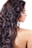 Young woman with long curly hair — Stock Photo