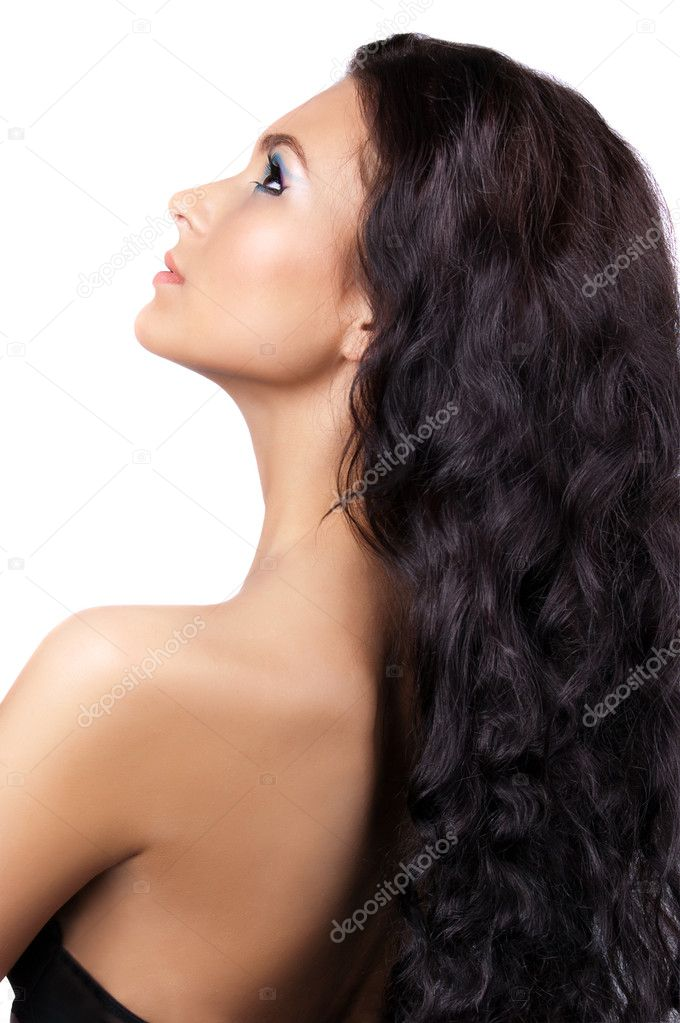 Young brunette woman with long shinycurly  hair isolated — Stock Photo #7227758
