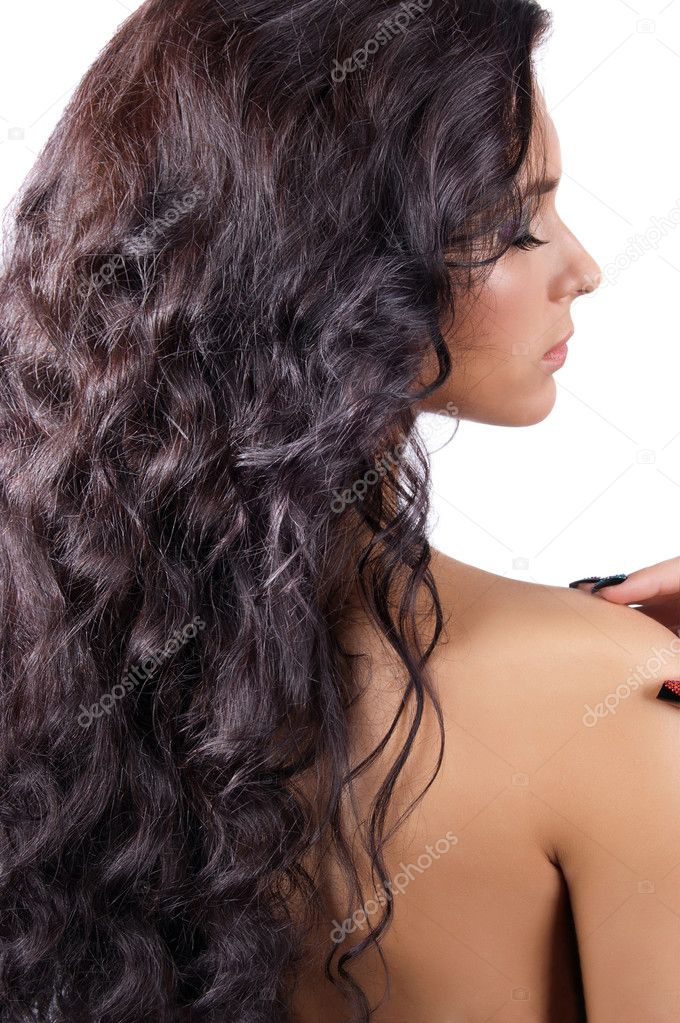 Young brunette woman with long shinycurly  hair isolated — Stok fotoğraf #7227775