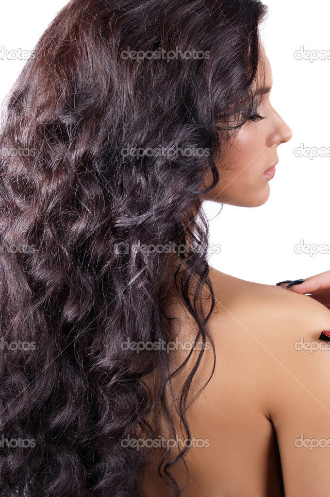 Young brunette woman with long shinycurly  hair isolated — Stockfoto #7227775