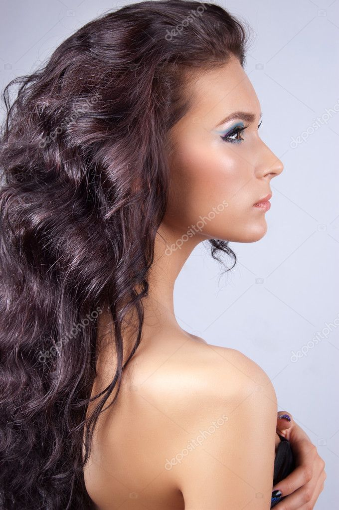 Young brunette woman with long shinycurly  hair isolated  Stock Photo #7227779