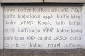 Kaffee in verschiedenen sprachen geschrieben — Stockfoto