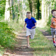 Young children running in nature — Stock Photo #7596810
