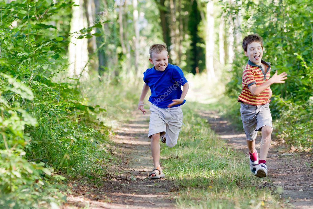 Young chidren running in nature — Stock Photo #7596810
