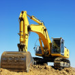 Yellow excavator on a working platform — Stock Photo