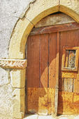 Old wooden door at medieval village,Portugal. — Stock Photo