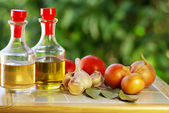 Oliveoil, vinegar and vegetables. — Stock Photo