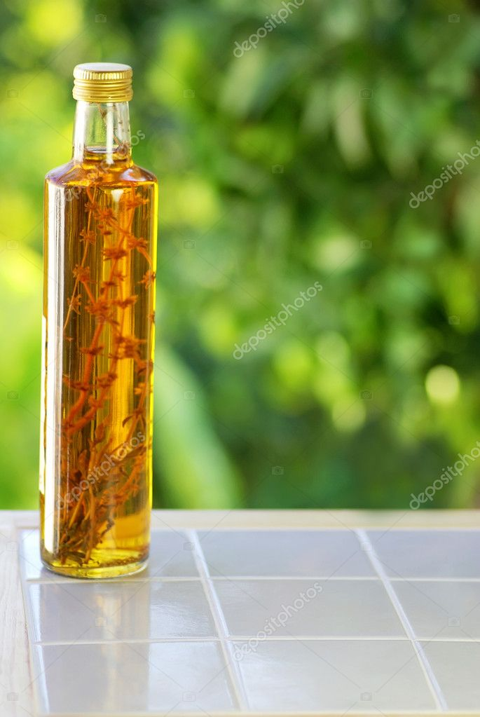 Bottle of vinegar on table. — Stock fotografie #7127929