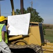 Stock Photo: Construction worker and dozer
