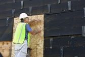 Carpenter on a ladder — Stock Photo