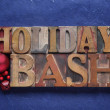 Foto Stock: Holiday bash words on blue