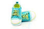 Spotted baby sneakers — Stock Photo