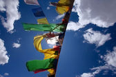 Praying flags floating in the wind — Stock Photo