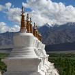 Landscape with stupas on mountain background — Stock Photo