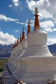 Landscape with stupas on mountain background — Stock Photo