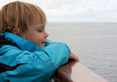 Child by boat railing — Stock Photo