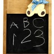 Child's blackboard with ABC and numbers - Stock Photo