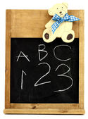 Child's blackboard with ABC and numbers — Stock Photo